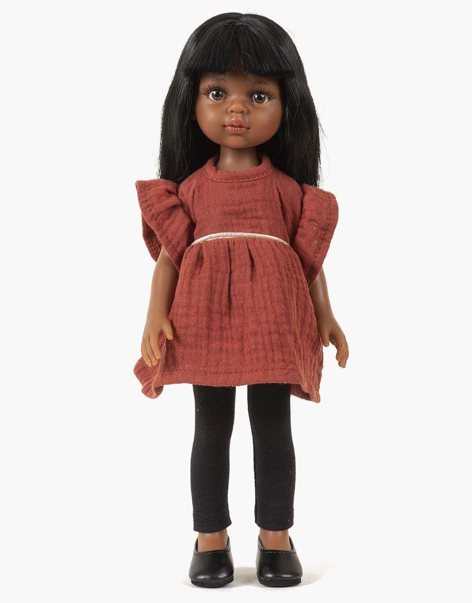 Minikane - Dressing pour poupées Amigas. Nora porte une robe tunique Daisy en double gaze de coton brique et son legging noir